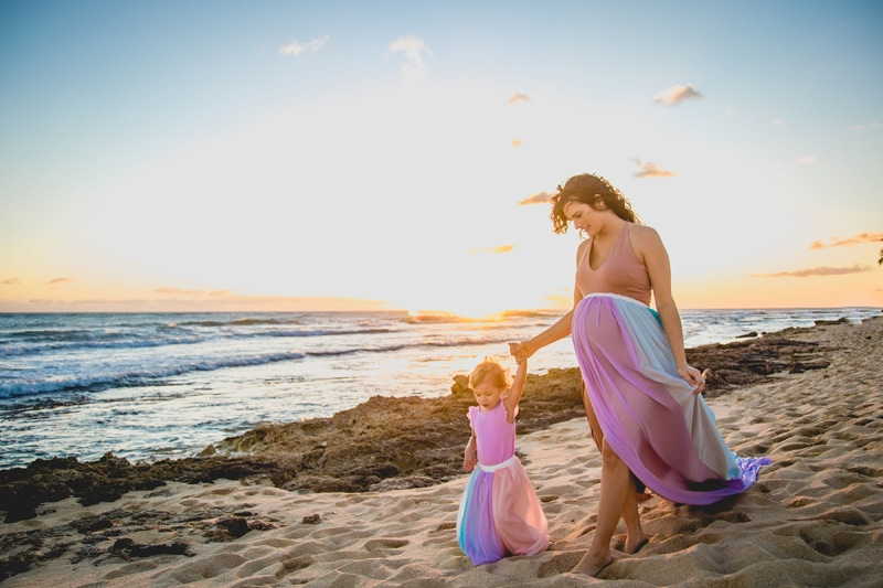 Oahu Family Photographer, mother and daughter walking along the beach in colorful dresses