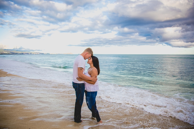 Oahu Family Photographer, couple standing close together on the beach